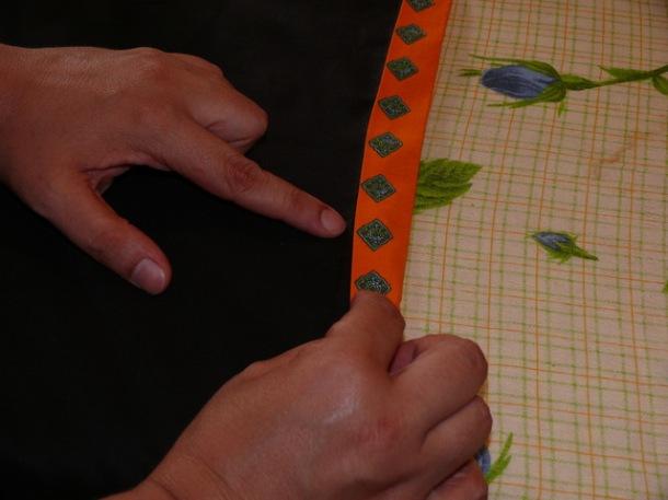 26_stirare tutta la cintura piegata a metà e cucire a mano con punto nascosto